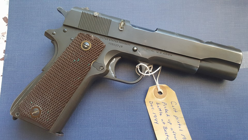 This shrapnel damaged M1911 made it through the Battle of the Bulge (2)