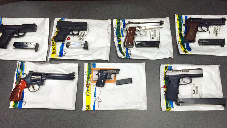 The Baltimore Police Department found these guns during a recent raid on the Safe Streets offices on E. Monument Street in July.  (Tom Brenner / Baltimore Sun)