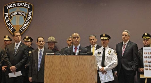 Officials in Providence hold a press conference after 35 people were arrested in February on charges stemming from drug and gun trafficking. (Photo: Steve Szydlowski / The Providence Journal)