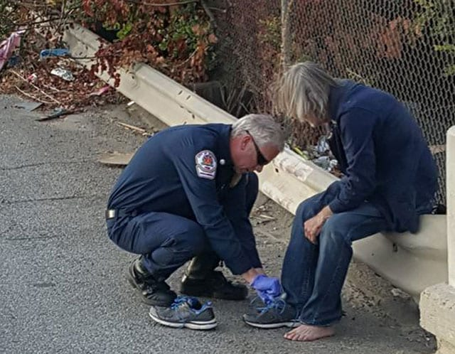 firefighters give shoes to homeless man
