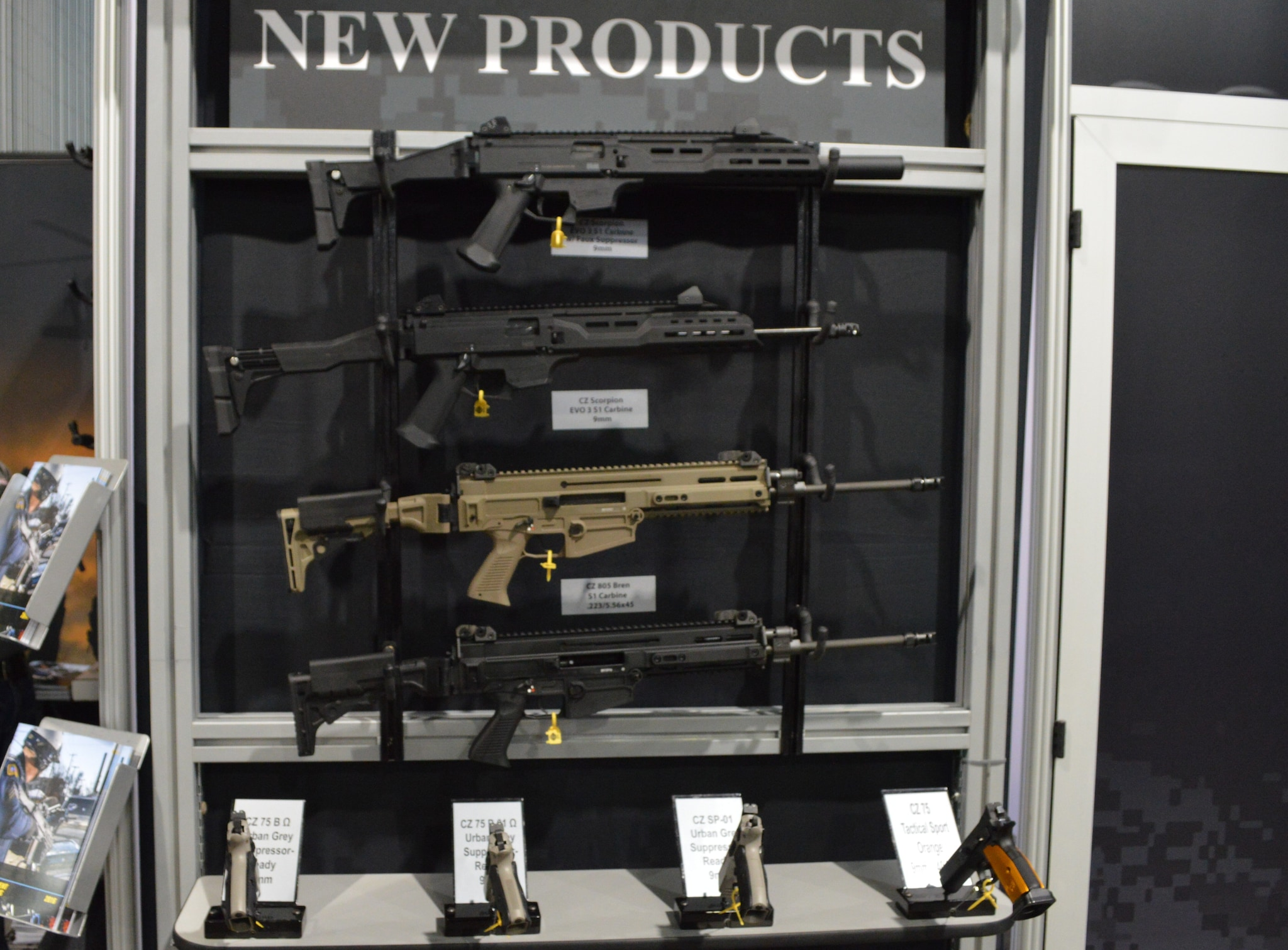 CZ's updated Scorpion EVO 2 S1 carbines, Bren S1 carbines, and a lineup of pistols including the CZ Tactical Sport Orange on the far right. (Photo: Kristin Alberts)