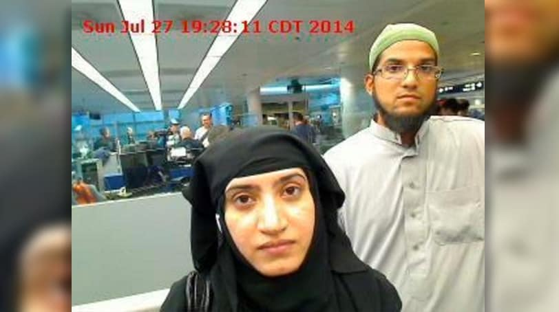 Tashfeen Malik and Syed Farook are pictured passing through Chicago's O'Hare International Airport in July 2014. (Photo: Reuters / US Customs and Border Protection)