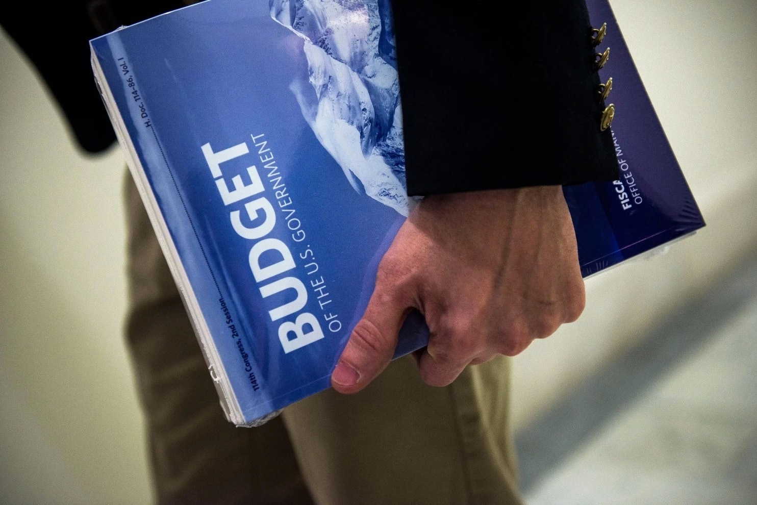 A congressional House staffer holds President Obama's fiscal 2017 budget in the House Budget Committee Room Feb. 9 on Capitol Hill. (Photo: Getty Images)