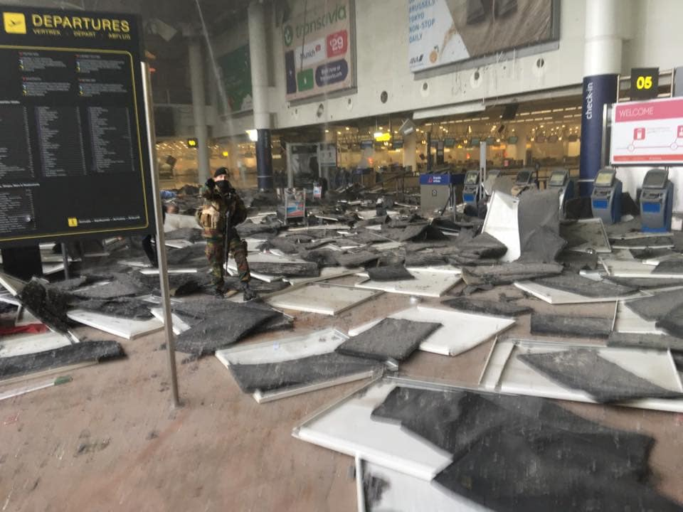 Debris can be seen scattered about after an explosion in Brussels International Airport Tuesday morning. (Photo: Jef Versele / Facebook)