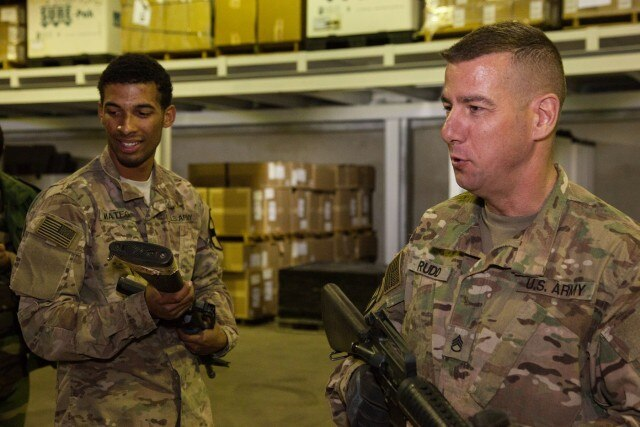 U.S. Army Staff Sgt. Kenneth Rudd, assigned to 77th Sustainment Brigade, and Spc. Daniel Mateo, with the 17th Sustainment Brigade, read the serial numbers of M16 rifles during a weapons inventory near Erbil, Iraq, Feb. 22, 2016.