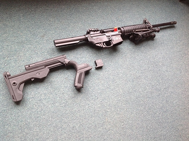 A_complete_look_at_the_components_prior_to_installation,_with_the_standard_6-position_buttstock_already_removed_from_the_S&W