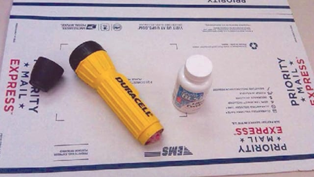 The shipment sent by the FBI to Cheng Le contained, among other things, a pill bottle holding a single phony ricin tablet. (Photo: FBI)