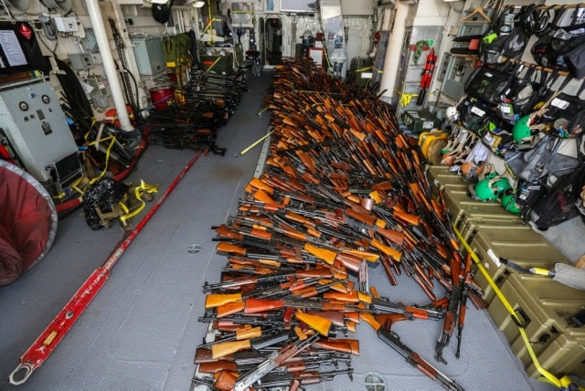 Weapons seized by HMAS Darwin from a small-arms smuggler boarded approximately 170 nautical miles off the coast of Oman on Feb. 27. (Photo: Combined Maritime Forces)