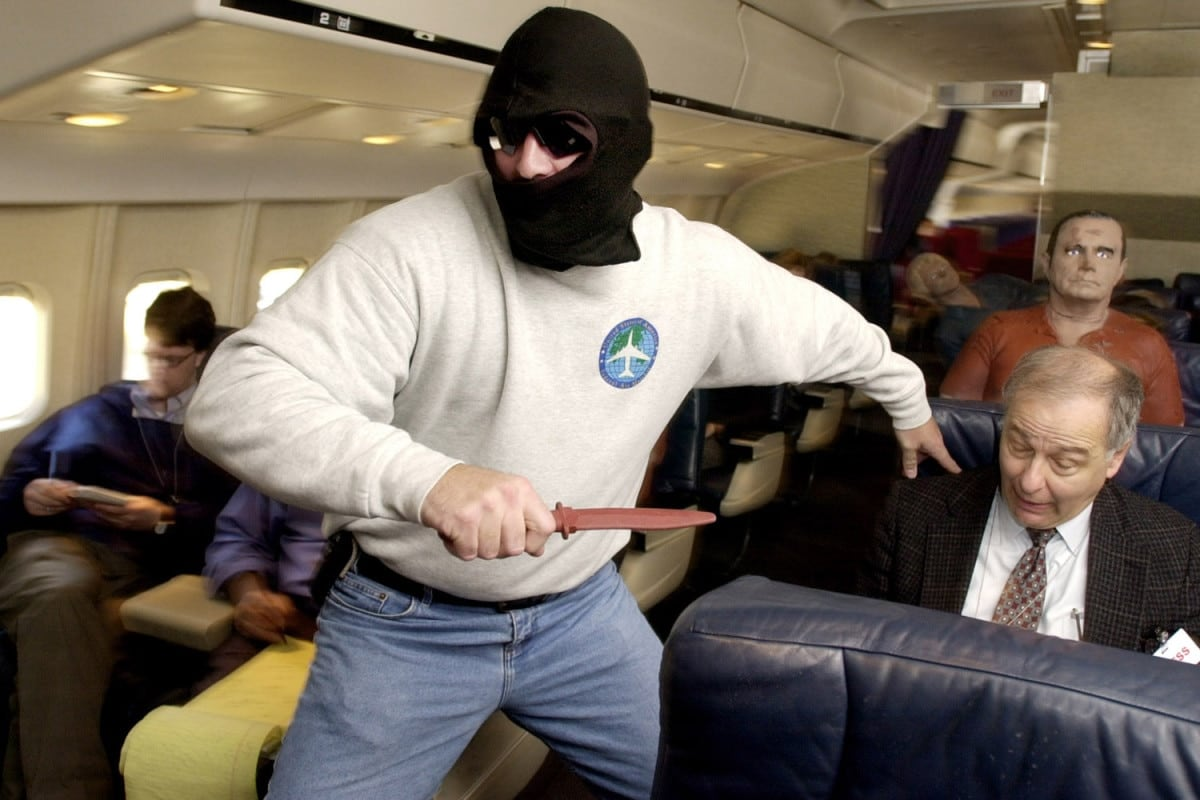 An FAA knife wielding sky marshal running between seats during a simulated hijacking. (Photo: Reuters)