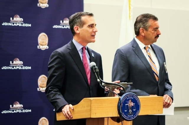 Mayor Eric Garcetti-- shown holding SDJ's M1911-- and LAPD Chief Charlie Beck presided over a press event this week showing off some of the guns turned in May 7. (Photo: LA Mayor's Office)