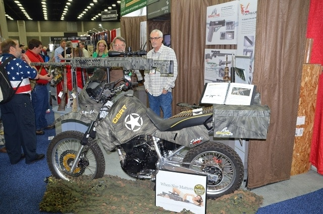 Why yes that is a MG Arms .50 BMG Behemoth mounted over the tank of this dirt-bike, good eye.