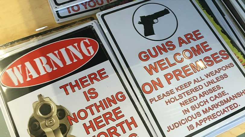 Pro-gun signs sit on the shelves of the Master Pawn of Horse Cave in Horse Cave, Kentucky. (Photo: Jared Morgan / Guns.com)