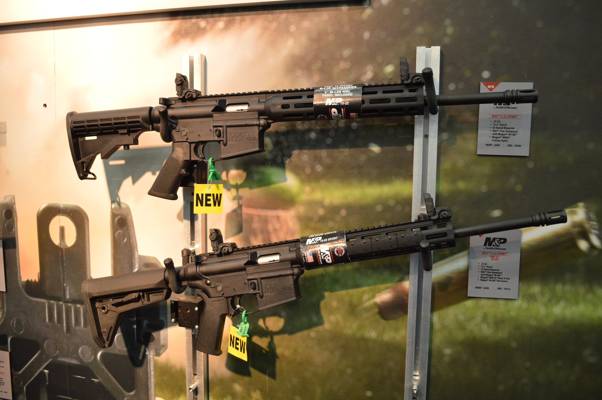 Smith & Wesson showed off the results of their partnership with Magpul. The M&P 15-22 AR-style rimfire rifle line has been dressed up. Top, an M&P slim handguard with Magpul M-Lok and MBUS backup sights. The lower MOE SL model wears the same handguard but also Magpul MOE SL stock & grip and Magpul M-LOK rail covers. Retail set at $449 and $499 respectively. (Photo: Kristin Alberts/Guns.com)