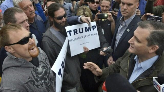 Donald Trump supporter, left, questioning Sen. Ted Cruz's record on Second Amendment issues. (Photo: Associated Press)