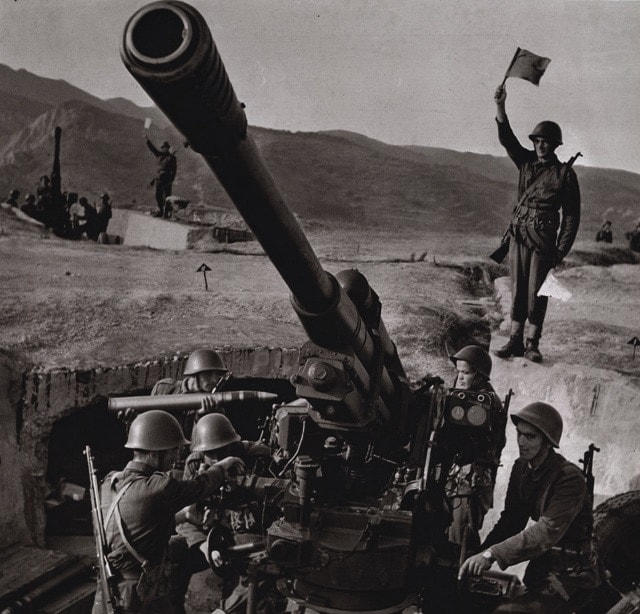 Albanian People`s Army troops man an obsolete M1939 85 mm AAA gun while they carry that country's unique SKS design with their distinctive extra-long gas tube covers. Albania withdrew from the Warsaw Pact in 1968 and after her already dated armament was frozen in time after that.