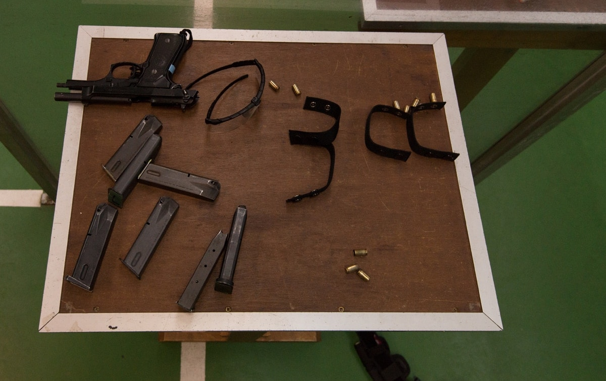 An M9 pistol and magazines on a table as U.S. Army Military Policemen train at a 25-meter firing range on Chièvres Air Base, Belgium, Nov. 14, 2014. (Photo: U.S. Army/Pierre-Etienne Courtejoie)