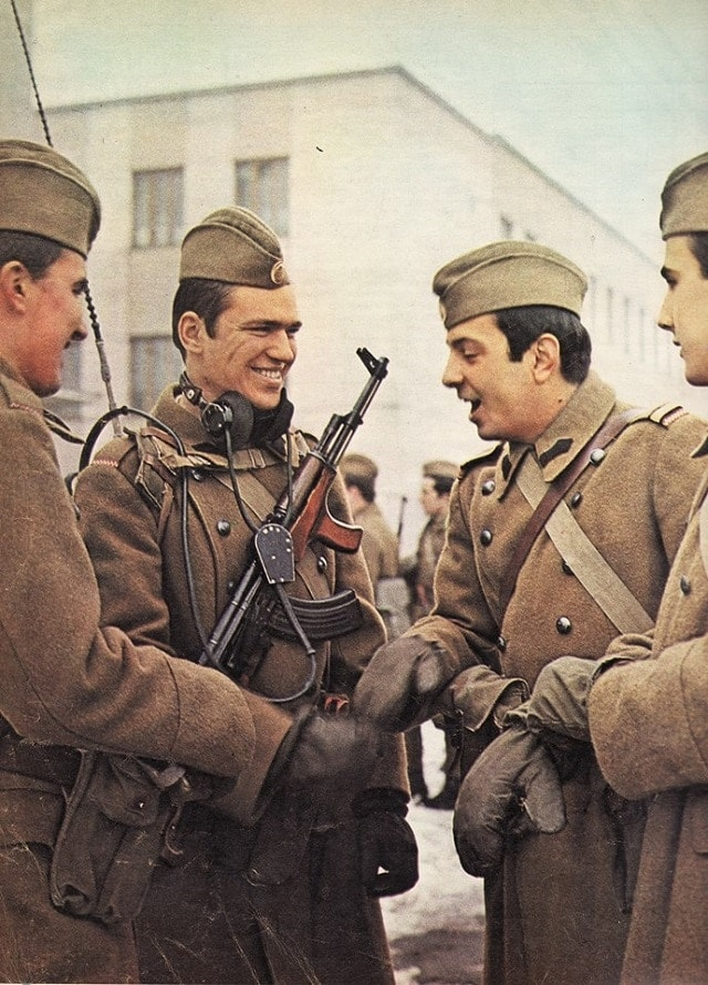 Romanian Army soldiers in 1976 digging that distinctive AK forearm grip used on Kalash made locally.