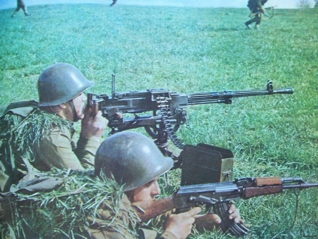 Albanian troops with a Soviet-made Gorunov SG-43 machine gun. You know that's some 7.62x54R love there...