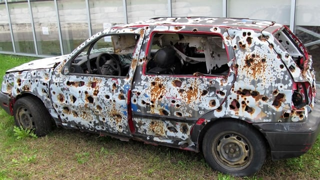 An example of a bullet-ridden vehicle, according to Google.