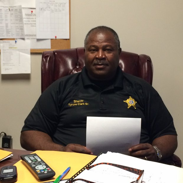 Sumter County Sheriff Tyrone Clark Sr. sits behind his desk at the Sumter County Sheriff's office in March 2016. (Connor Sheets | AL.com)