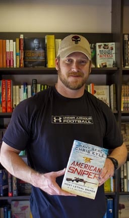 """Chris Kyle posing with his book """"American Sniper."""" (Photo: Kyle)"""