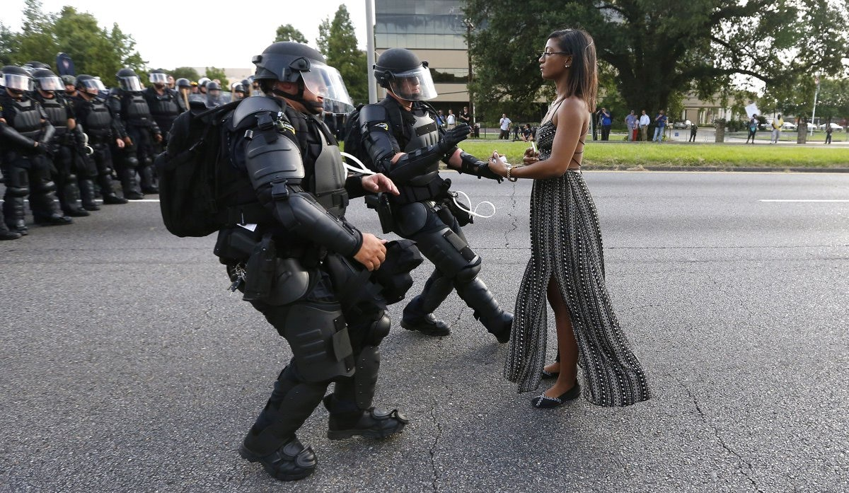 Police confront a protester in Baton Rouge this weekend. (Photo: Jonathan Bachman/Reuters)