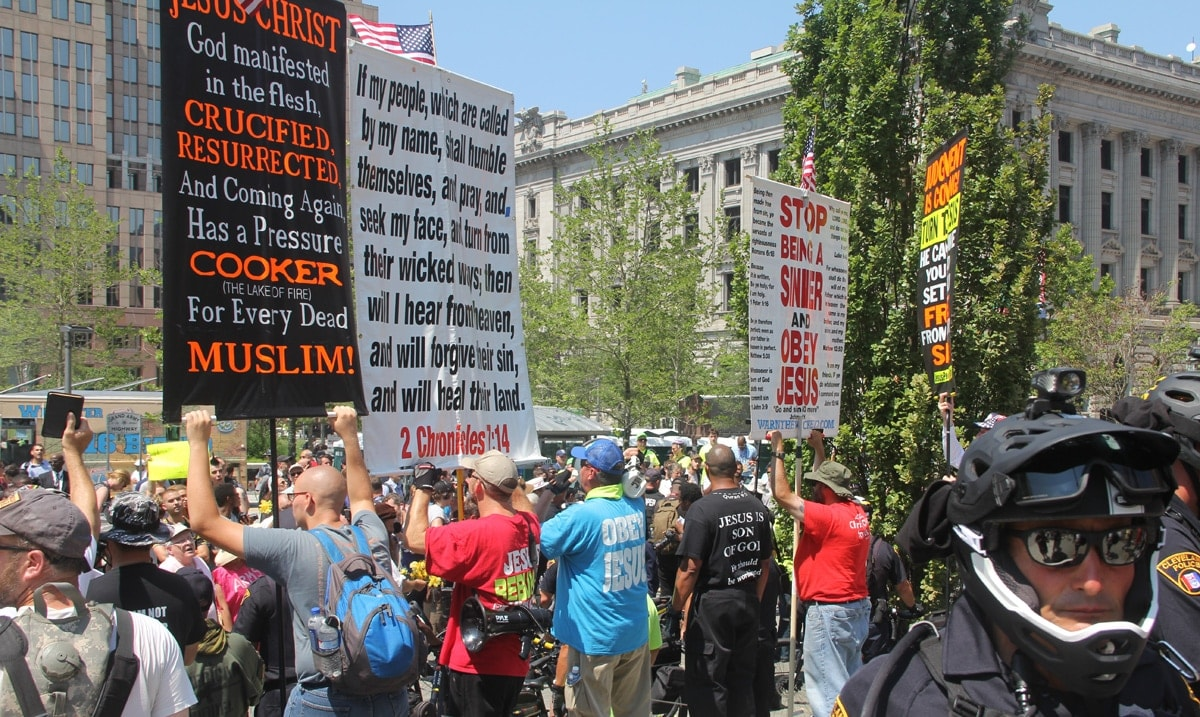 Demonstrators with signs and megaphones spouting some incoherent religious message.