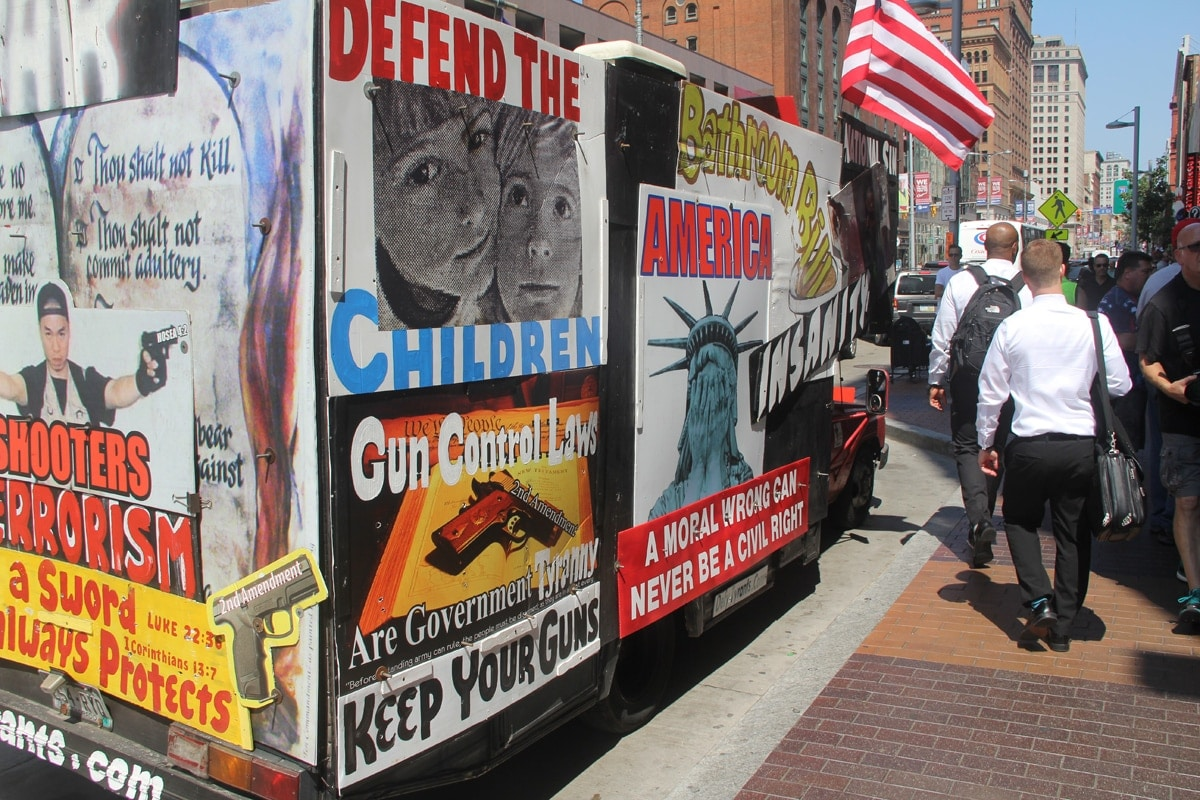 A truck with signs that appear to be pro-gun.