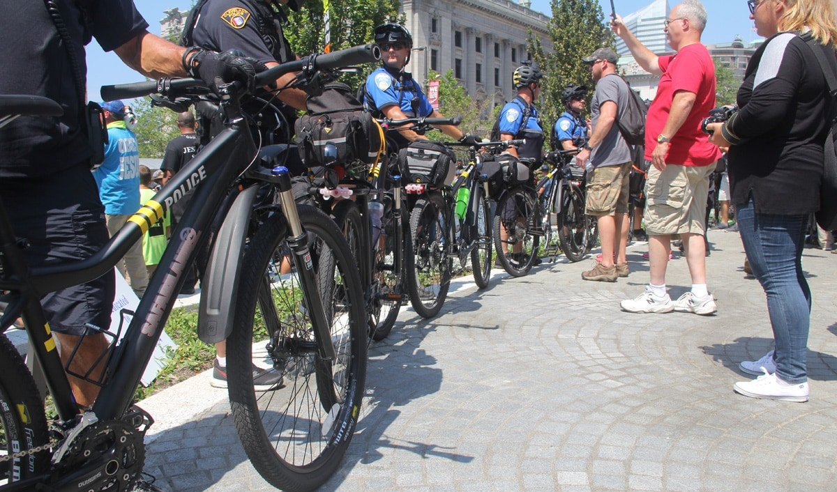 Police protecting the religious demonstrators with a blockade of bikes.