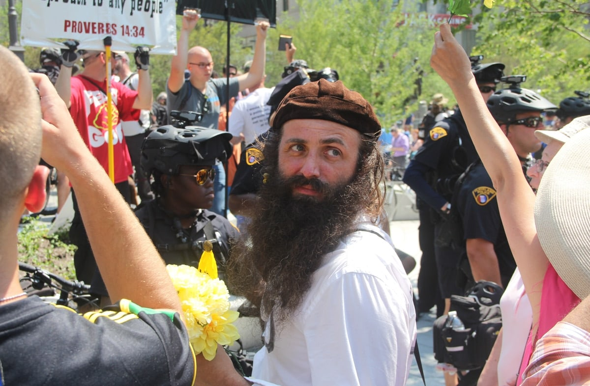 A protestor confronting the main speaker with his own megaphone. He had just quoted scripture from memory.