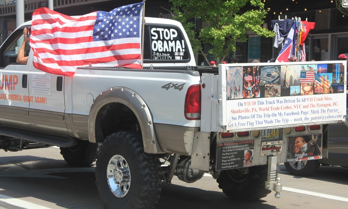 A person who decorated his truck with political rhetoric. He drove around the block near the Quicken Loans Convention Center.
