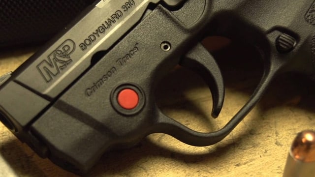 A Smith & Wesson pistol equipped with a Crimson Trace laser sight. (Photo: Youtube)