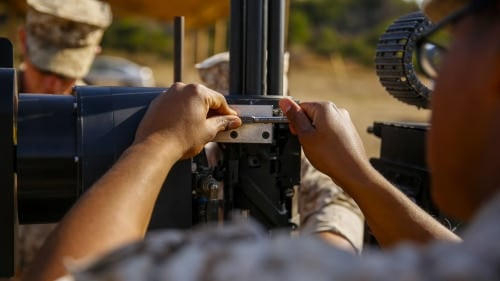 Lance Cpl. Jorge Sainz, a rifleman with Kilo Company, 3rd Battalion, 5th Regiment, attaches the M134 Minigun to the Robotic Vehicle Modular system aboard Camp Pendleton, June 23, 2016. The Marines were learning how to operate the system which is going to be tested during Rim of the Pacific 2016 with partner nations. The RVM is designed to assist an infantry platoon by providing more fire power, bearing equipment loads and designating targets for air assaults. The Marine Corps Warfighting Laboratory is conducting a Marine Air-Ground Task Force Integrated Experiment to explore new gear and access its capabilities for potential future use. (U.S. Marine Corps photo by Lance Cpl. Frank Cordoba/Released)