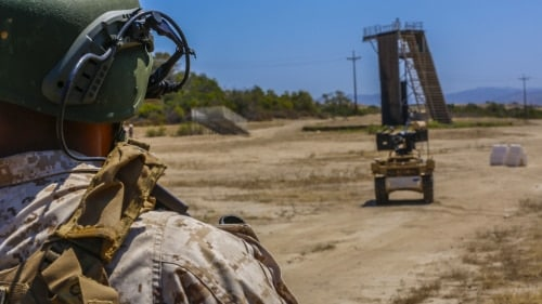 Lance Cpl. Leonardo Reyes, an infantryman with Kilo Company, 3rd Battalion, 5th Regiment, controls the weapon payload of the robotic vehicle modular system aboard Camp Pendleton, Calif., June 26, 2016. Reyes and other Marines from his unit were learning how to operate the system in preparation of exercise Rim of the Pacific with partner nations. (U.S. Marine Corps photo by Lance Cpl. Frank Cordoba/Released)