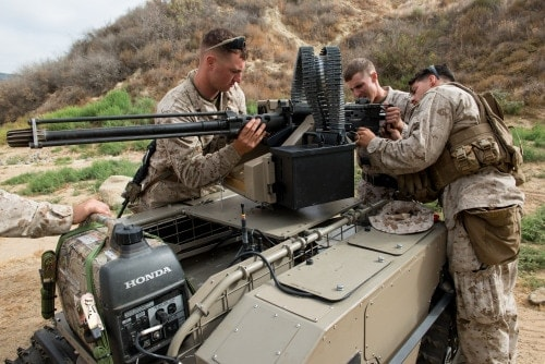Marines with 3rd Battalion, 5th Marines Regiment prepare a newly developed system, the Multi Utility Tactical Transport, for testing at Marine Corps Base Camp Pendleton, Calif., July 8, 2016. The MUTT is designed as a force multiplier to enhance expeditionary power enabling Marines to cover larger areas and provide superior firepower with the lightest tactical footprint possible. The Marine Corps Warfighting Laboratory is conducting a Marine Air-Ground Task Force Integrated Experiment in conjunction with Rim of the Pacific exercise to explore new gear and assess its capabilities for potential future use. The Warfighting Lab identifies possible challenges of the future, develops new warfighting concepts, and tests new ideas to help develop equipment that meets the challenges of the future operating environment.