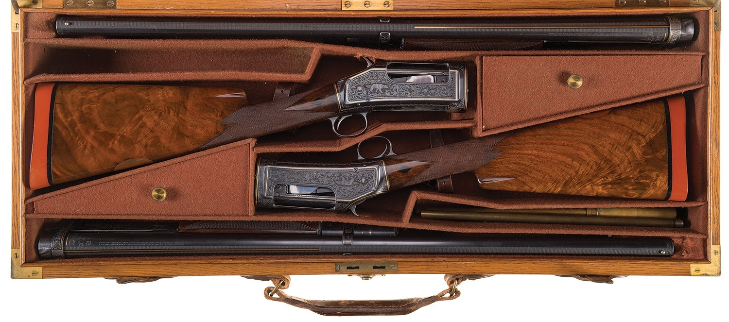 John Ulrich engraved and gold inlaid caseed and consecutively serialized Winchester Black Diamond Trap Models with 30-inch barrels 1905 1897
