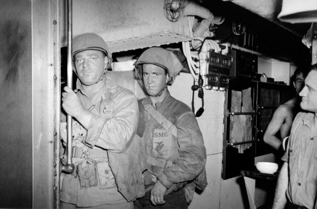 Marine Raiders prepare to depart their ride, a U.S. Navy Narwahl-class submarine, which transported them to Makin atoll.