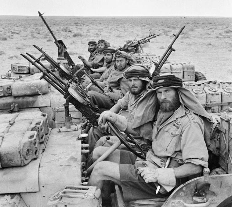 A close-up of a heavily armed patrol of 'L' Detachment SAS in their Jeeps, just back from a three month patrol in North Africa 1942. The crews of the jeeps are all wearing 'Arab-style' headdress, as copied from the Long Range Desert Group. (Photo: Imperial War Museum)