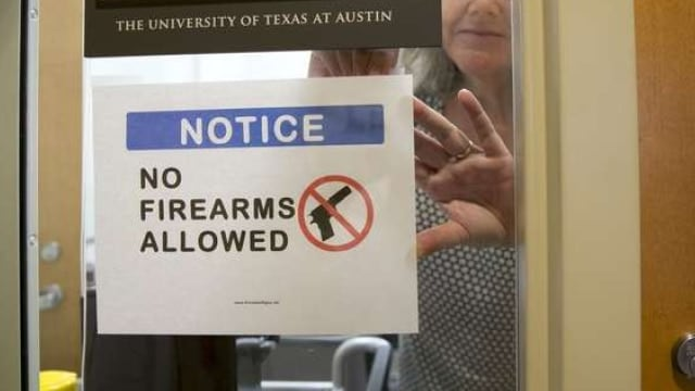Jay Janner/The Statesman https://www.statesman.com/news/news/state-regional-govt-politics/paxton-wants-ut-professors-campus-carry-lawsuit-to/nr8Wq/ UT anthropology professor Pauline Strong posts a sign prohibiting guns at her office at the Student Activity Center on the first day of the new campus carry law Monday.