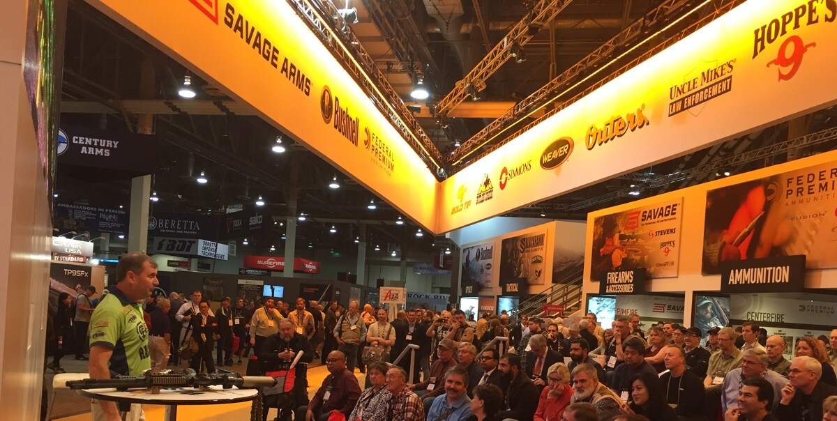 Vista pro-shooter Todd Jarrett, left, waxes poetic in front of a crowd during a demonstration at SHOT Show in Las Vegas in January 2016. (Photo: Daniel Terrill)