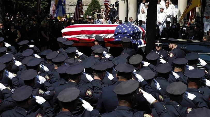 Police officers salute as the casket carrying slain Jersey City police officer Melvin Santiago is carried into St. Aloysius Catholic Church for his funeral service in Jersey City, New Jersey on July 18, 2014. (Photo: Reuters)
