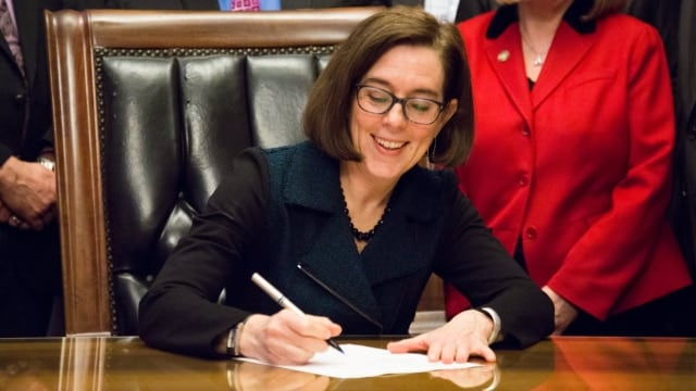 Oregon Gov. Kate Brown signed a bill mandating background checks for most private gun transfers in the state last year and is backing more firearm restrictions. (Photo: Kate Brown for OR)