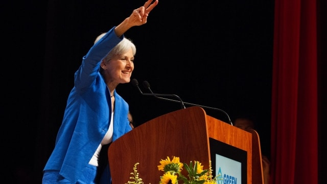 """Jill Stein tosses her signature """"peace sign"""" at the audience upon accepting the Green Party Presidential nomination at the 2016 Green Party National Convention. (Photo: Emily S. Chambers Photography via Jill Stein 2016)"""