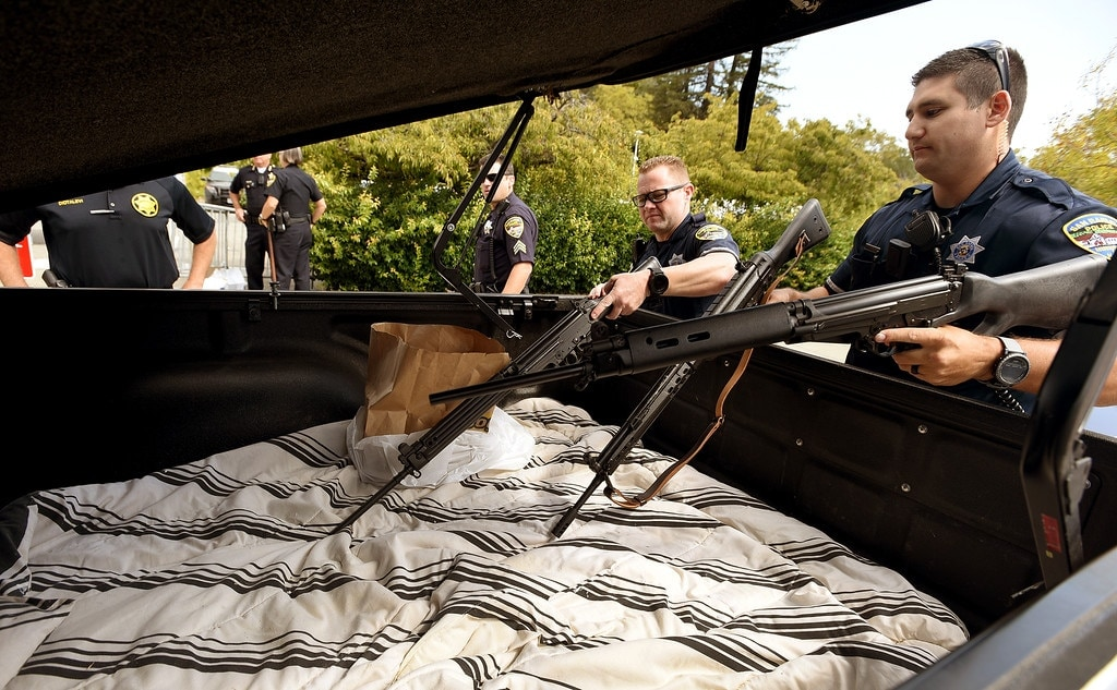 San Rafael Police officers David Casalnuovo, left, and Anthony Scalercio remove rifles from the back of this pick-up during a gun buyback at the San Rafael Police department on Tuesday, Sept. 13, 2016. (Photo: Robert Tong/Marin Independent Journal)