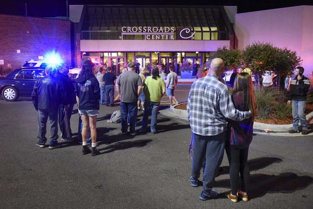 Shoppers stand near an entrance to Crossroads Mall where a man stabbed nine people before an off-duty cop shot and killed the suspect. (Photo: Dave Schwarz/Associated Press)