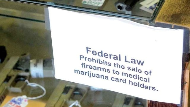 An appeals court found this week that there is enough suspicion that a medical marijuana cardholder is a user of illegal drugs that FFLs should continue to deny gun sales to them. (Photo: nwmjlaw.com)