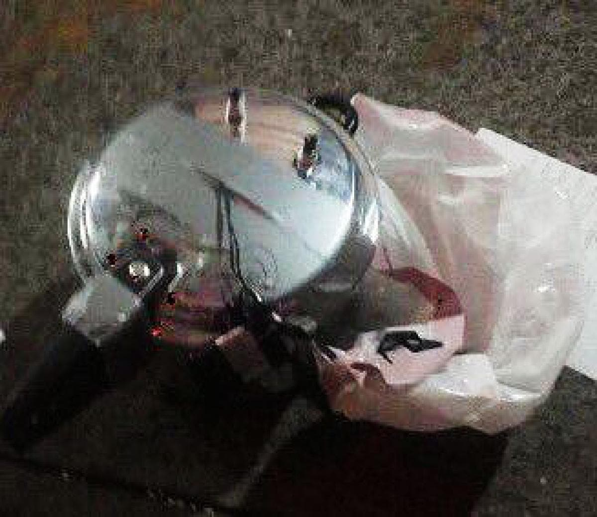 A pressure cooker bomb was found wrapped in a white garbage bag a few blocks from the first blast site. (Photo: NY Daily News)