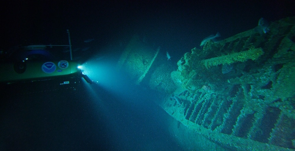 During the very first dive of the expedition, scientists located and explored the German U-576. This was the first time since the submarine was sunk on July 15, 1942, that anyone had laid eyes on the vessel. Here, Project Baseline's Nemo submersible shines its lights on the U-boat lying on its starboard side, showing the submarine's conning tower and the deck gun in the foreground. (Photo: NOAA)