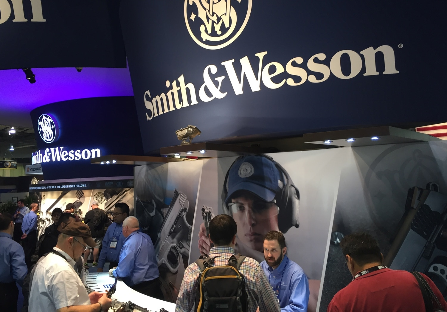 Representatives and patrons talking at the Smith & Wesson booth during SHOT Show in January 2016. (Photo: Daniel Terrill)