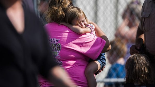 A child cries after being picked up by a caretaker at a Townville church following the shooting on Sept. 28, 2016. (Photo: Katie McLean/Independent Mail)
